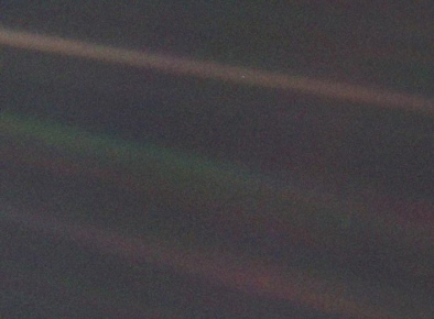 This narrow-angle color image of the Earth, dubbed 'Pale Blue Dot', is a part of the first ever 'portrait' of the solar system taken by Voyager 1. The spacecraft acquired a total of 60 frames for a mosaic of the solar system from a distance of more than 4 billion miles from Earth and about 32 degrees above the ecliptic. From Voyager's great distance Earth is a mere point of light, less than the size of a picture element even in the narrow-angle camera. Earth was a crescent only 0.12 pixel in size. Coincidentally, Earth lies right in the center of one of the scattered light rays resulting from taking the image so close to the sun. This blown-up image of the Earth was taken through three color filters -- violet, blue and green -- and recombined to produce the color image. The background features in the image are artifacts resulting from the magnification. (Photo by NASA/Handout/Corbis via Getty Images)