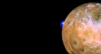 Voyager 1 image of Io showing active plume of Loki on limb. Heart-shaped feature southeast of Loki consists of fallout deposits from active plume Pele. The images that make up this mosaic were taken from an average distance of approximately 490,000 kilometers (340,000 miles). Image credit: NASA/JPL/USGS